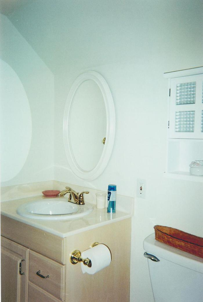 1/2 First Floor Bath (powder room) and full laundry  - 123 Seaport Blvd.